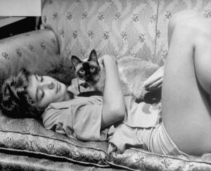 Woman Cuddling Cat by Alfred Eisenstaedt